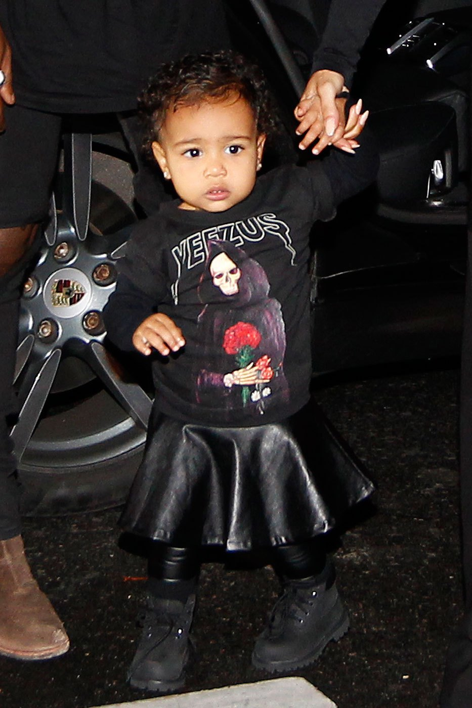 24 Sep 2014, Paris, France --- Kanye West, Kim Kardashian and their daughter North West walk to the Balenciaga Womenswear Spring/Summer 2015 during Paris Fashion Week in Paris, France. Pictured: North West --- Image by © Splash News/Splash News/Corbis